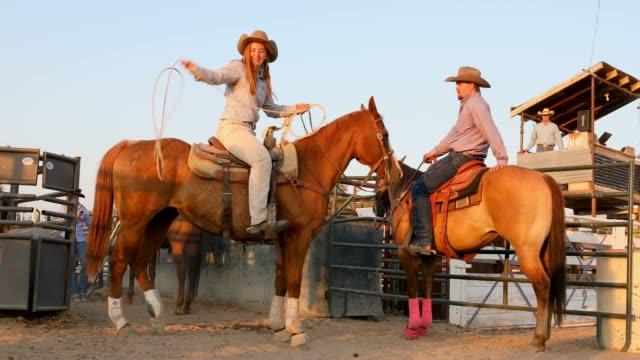 Cowgirl on Horseback Doing Lariat Tricks video