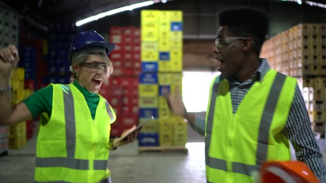 coworkers celebrating, dancing and using digital tablet - prodotti supermercato video stock e b–roll