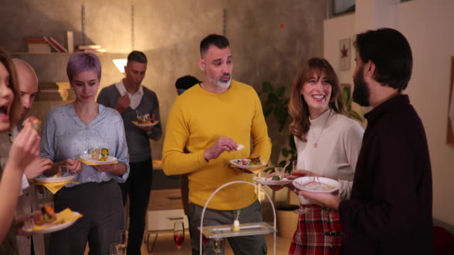 Co-workers eating delicious appetizers on networking event