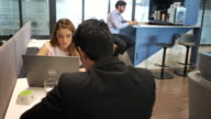 istock Coworking in modern Hispanic business - millennials working together 1200607670