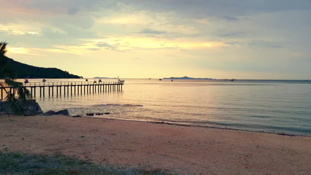 Cozy beach and sand with golden sky at sunset Beautiful beach with sunset, Pattaya, Thailand. pattaya stock videos & royalty-free footage