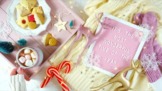 Cozy Christmas indoors tray of goodies with letter board stop motion overhead.