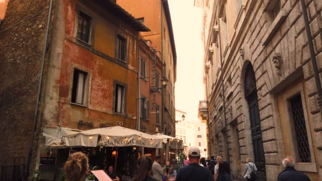 a cozy narrow street in the old historical part of rome - stabilized shot стоковые видео и кадры b-roll