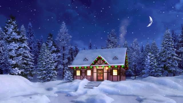 stockvideo's en b-roll-footage met gezellig landelijk huis ingericht voor kerstmis op besneeuwde winter nacht - christmas cabin