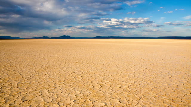Cracked earth in remote Alvord Desert, Oregon, USA, timelapse Timelapse of moving clouds over cracked earth in a dry lakebed in the Alvord desert in southeastern Oregon, USA. dry stock videos & royalty-free footage