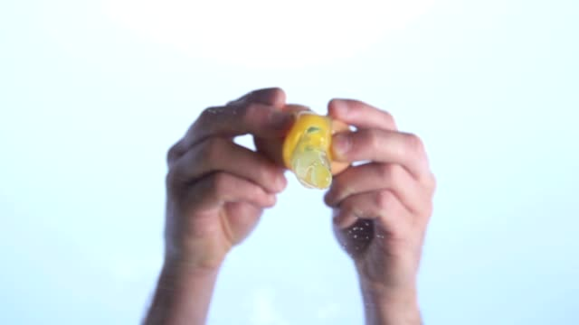 Cracking an Egg in hot sun Slow Motion HD video