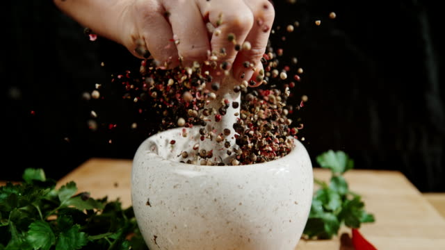 SLO MO Cracking peppercorns Super slow motion shot of an unrecognizable person cracking peppercorns in the mortar. mortar and pestle stock videos & royalty-free footage