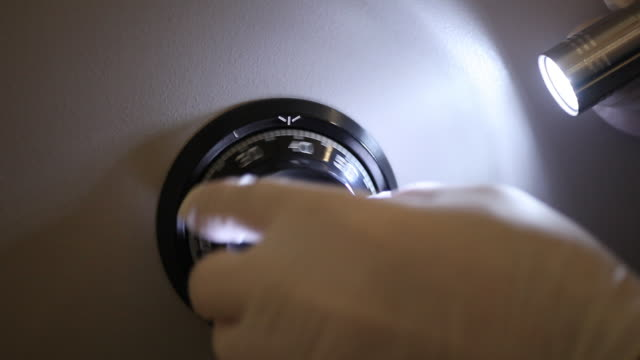Cracking vaulted door, illuminated by flashlight video