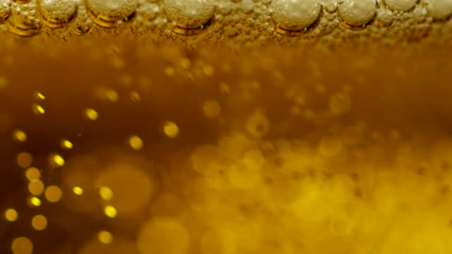 craft beer and traditional irish pubs. macro bubbles, craft lager perfectly pinned professional dowel. pubs and bars. freshness and refreshing beverages - большой кувшин стоковые видео и кадры b-roll