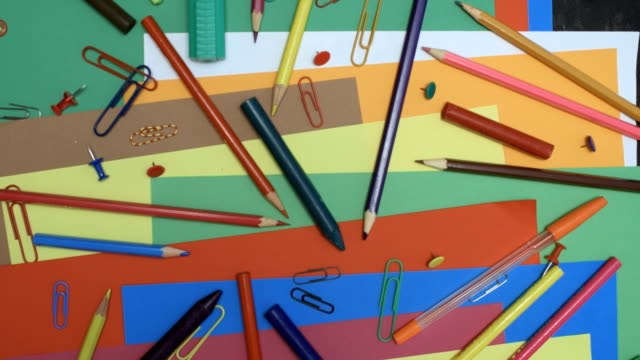 Craft supplies over colorful paper video
