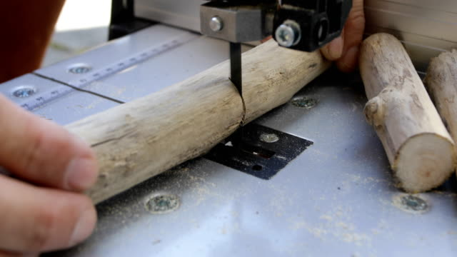 DIY craftsman cutting driftwood using band-saw video