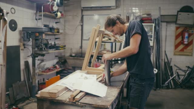 Craftsman designing new product in workshop