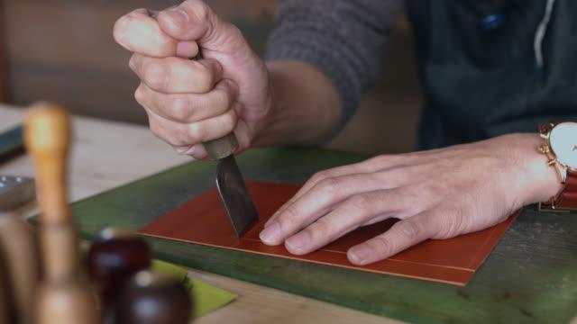 職人の手加工レザー - 自家製点の映像素材/bロール