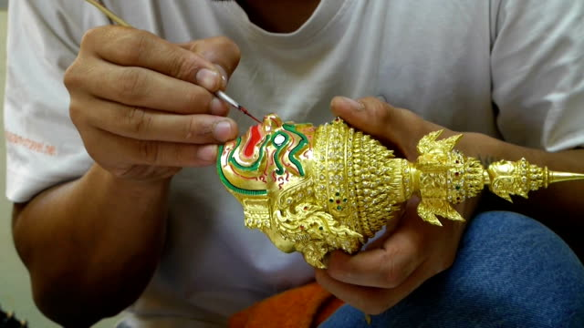 Craftsman painting the small scale Khon mask. video