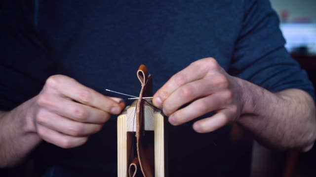 Crafts-person sewing leather case