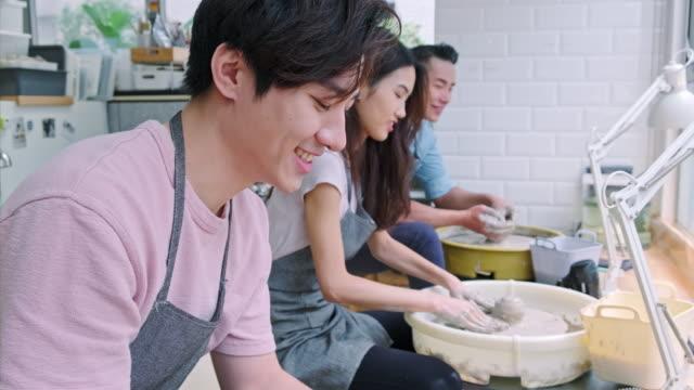 Craftsperson working at pottery workshop