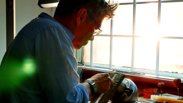 Craftswoman working in workshop video