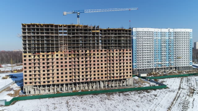 Crane and a multi-storey house under construction video