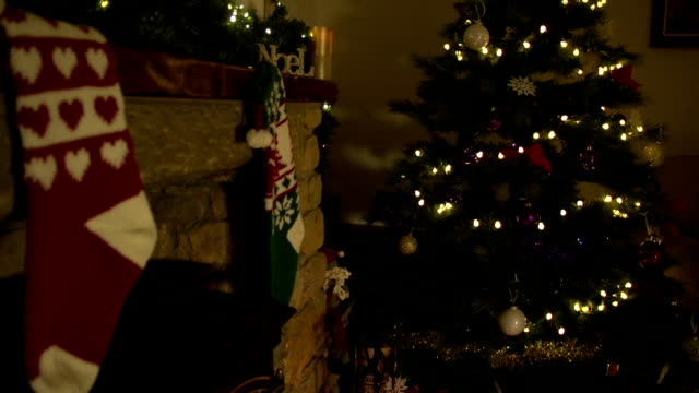 HD Crane: Christmas Stockings hung on fireplace by Tree video