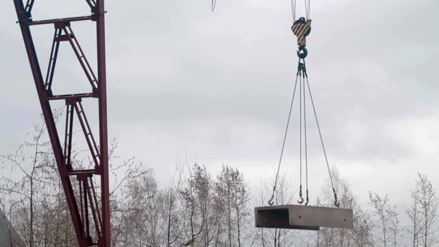 Crane lowers concrete slab video