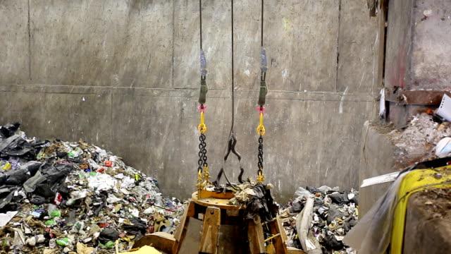 Crane moving piles of garbage video