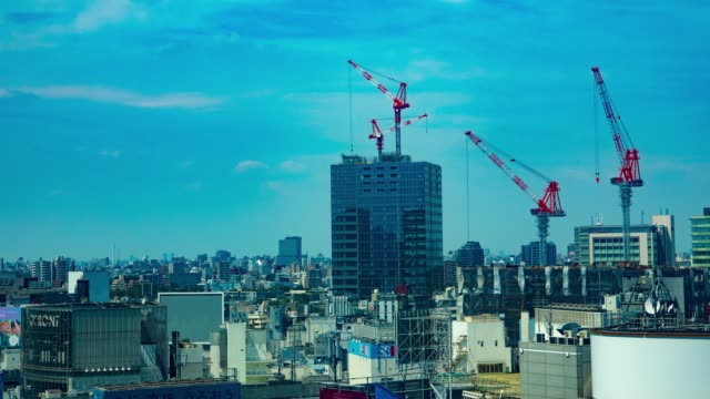 Crane on the building in Shibuya Tokyo time lapse It's a crane on the building in Shibuya Tokyo construction machinery stock videos & royalty-free footage