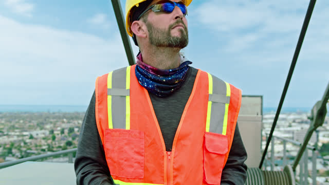 Crane Operator Walks Forward Looking Either Way video