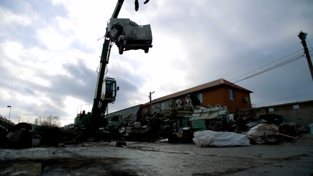 Crane Peel Grabber Destroys a Car for Recycling video
