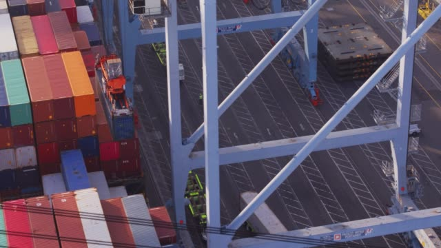 Crane Pulling Container from Belly of Cargo Ship video