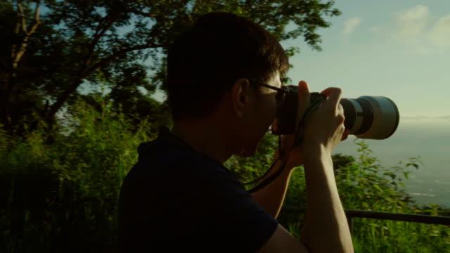 Crane shot male photographer taking of landscape city video