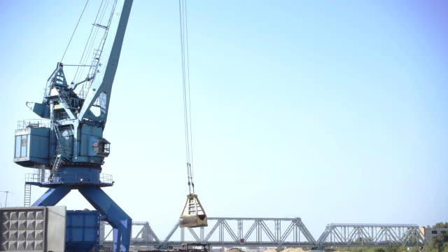 Crane working in a river port video