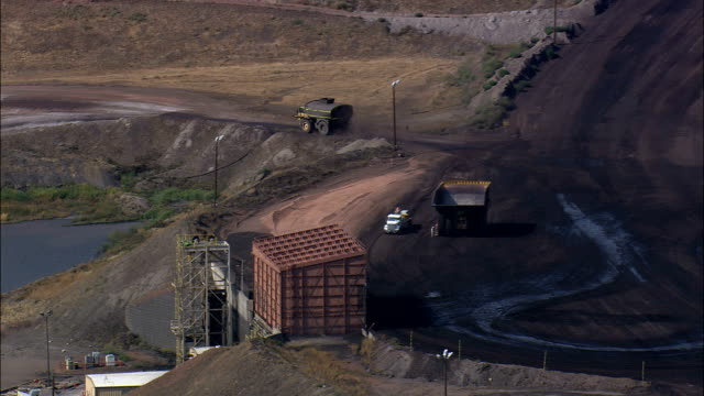 Cranes And Trucks  - Aerial View - Wyoming, Campbell County, United States video