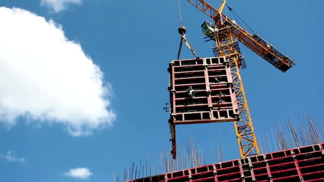 Cranes in construction site video