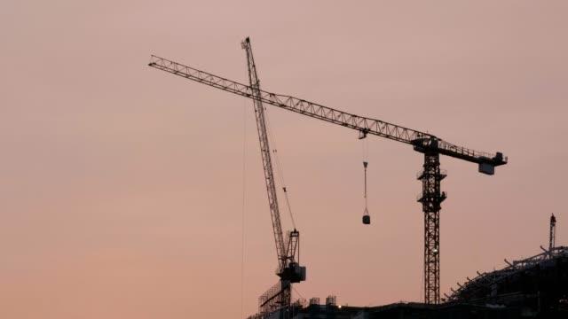 Cranes in construction site.