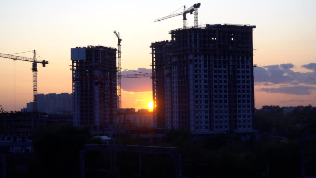 Cranes working day and night on construction of the housing estate in former industrial zone