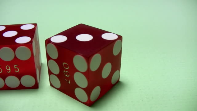 Craps - two red dice on green background video