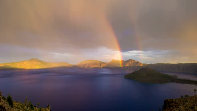 Crater Lake Rainbow Oregon Time lapse of crater lake in oregon during a thunder storm with a beautiful double rainbow. rainbow stock videos & royalty-free footage