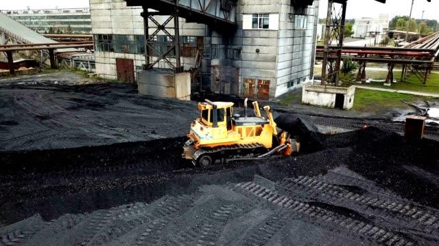 Crawler bulldozer sorts coal. Crawler bulldozer sorts coal. Industry. Aerial view. construction vehicle stock videos & royalty-free footage