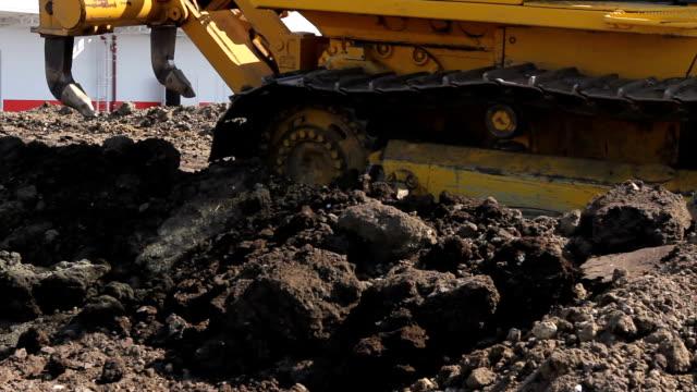 Crawler's tracks, bulldozer machine is leveling construction site video