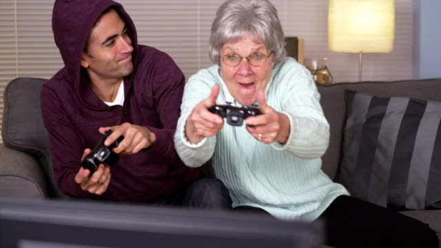 Crazy grandma beating her grandson at videogames Crazy grandma beating her grandson at videogames grandmother stock videos & royalty-free footage