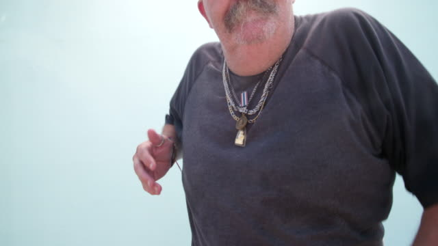 Crazy looking man with mustache is dancing weird video
