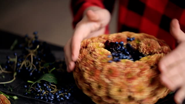 Creation composition of chrysanthemums and berries by florist video