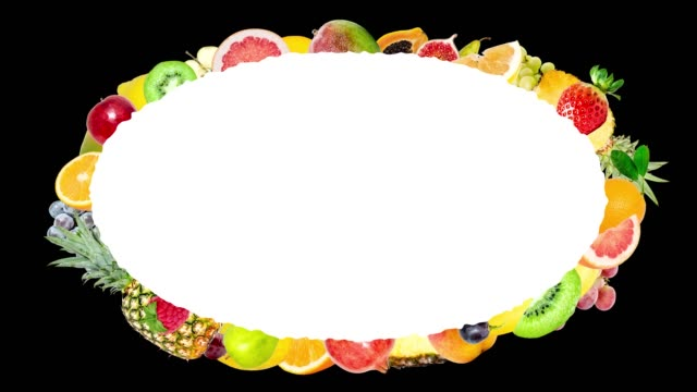 Creative 4k stop motion animation of many different fruits flying from the center and slowing down around a beautiful oval frame with space for text and flying fast. Fruit explosion on a black.
