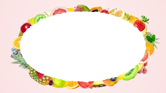 Creative 4k stop motion animation of many different fruits flying from the center and stopping around a beautiful oval frame with place for text. Fruit explosion on a summer soft pink background.