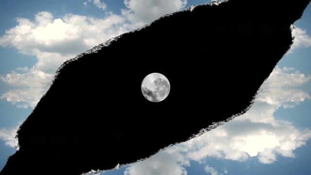 Creative 4k time laps video hole in the sky with moving clouds with torn edges, like on paper, and moving into the camera in this hole from the darkness of space full of luminous moon. A hole in space.