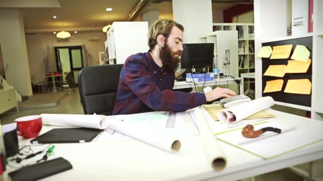 Creative architect at work in studio video