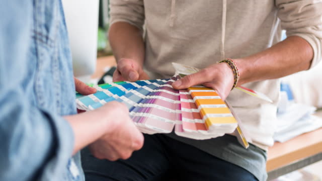 Creative business people choosing the colors for the new advertising design