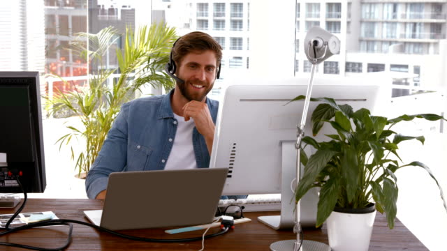 Creative businessman in a video conference video