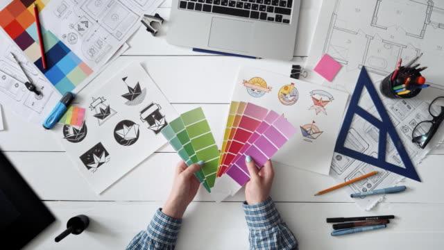 creative designer choosing color palette for logo design - tavolozza video stock e b–roll