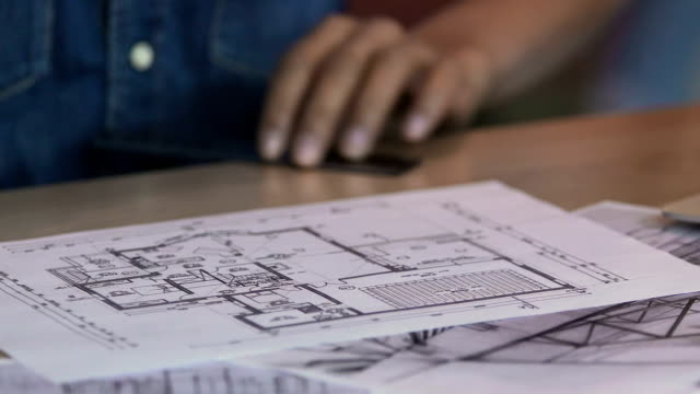 Creative freelancer working on apartment plan, drawing interior design project – Video